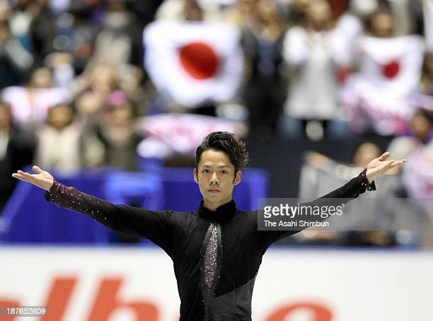 Daisuke Takahashi of Japan reacts after competing in the Men's Short Program during day one of the ISU Grand Prix of Figure Skating 2013/2014 NHK...