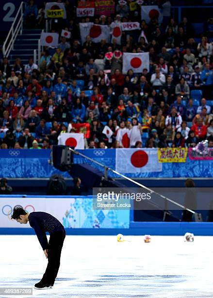 Daisuke Takahashi of Japan throws bows after he competes during the Figure Skating Men's Free Skating on day seven of the Sochi 2014 Winter Olympics...