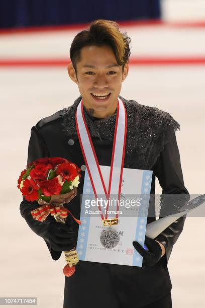 Daisuke Takahashi poses with his silver medal after the men's free skating on day four of the 87th Japan Figure Skating Championships at Towa Yakuhin...