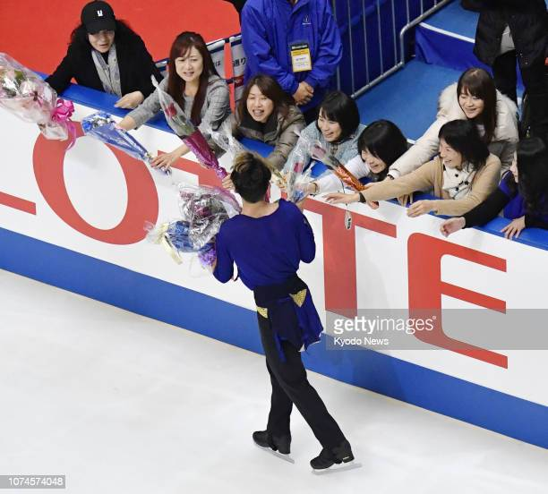 Daisuke Takahashi receives flowers from fans after performing in the men's short program at the national figure skating championships in Kadoma Osaka...