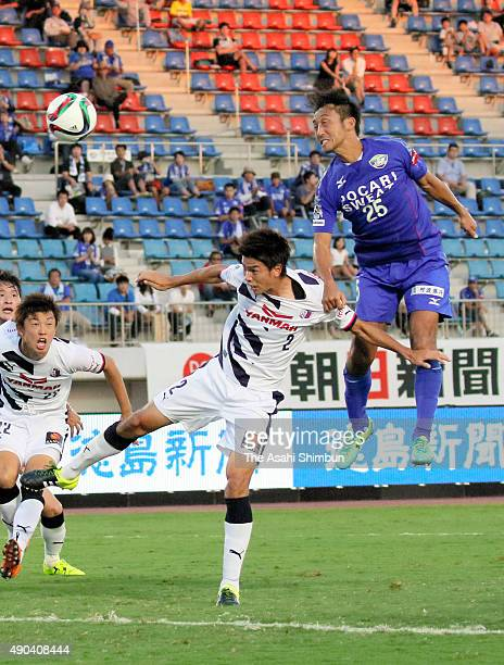 Daisuke Tomita of Tokushima Vortis heads the ball to score his team's first goal during the JLeague second division match between Tokushima Vortis...