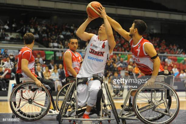 Daisuke Tsuchiko of Japan shoots during the Wheelchair Basketball World Challenge Cup third place match between Turkey and Japan at the Tokyo...