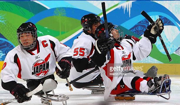 Daisuke Uehara of Japan celebrates scoring a goahead goal with teammates Takayuki Endo and Kazuhiro Takahashi during the third period of the Ice...