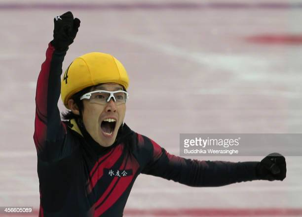 Daisuke Uemura celebrates after he won the Men's 500m final during the Short Track Olympic Qualifying Championships at Osaka Pool Ice Skating Rink on...