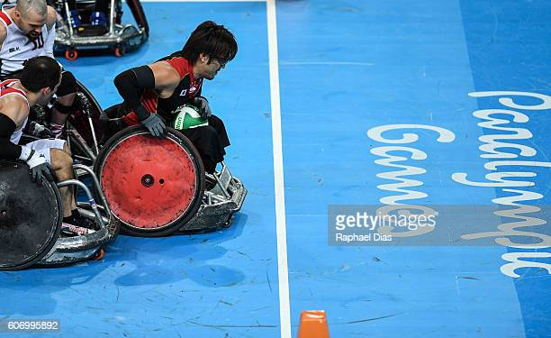 Daisuki Ikezaki of Japan competes during Wheelchair Rugby match between United States and Japan on day 9 of the Rio 2016 Paralympic Games at on...