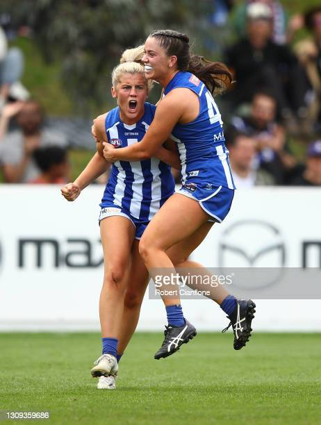 Daisy Bateman of the Kangaroos celebrates after scoring a goal during the round 9 AFLW match between the North Melbourne Kangaroos and the Fremantle...