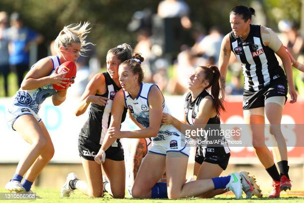 Daisy Bateman of the Kangaroos runs with the ball during the AFLW Finals Series match between the Collingwood Magpies and the North Melbourne...