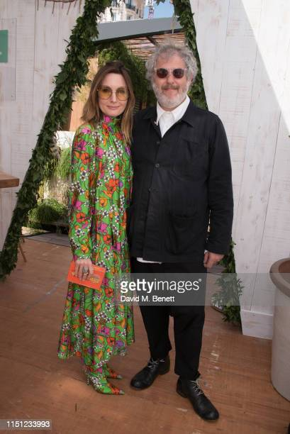 Daisy Bates and Malcolm Venville attend a cocktail party hosted by Alejandro Agag ahead of the World Premiere of the Formula E documentary And We Go...