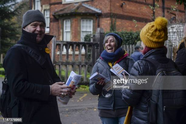 Daisy Cooper, candidate for the Liberal Democrat Party in the St. Albans constituency, center, campaigns with a team of volunteers in the Clarence...