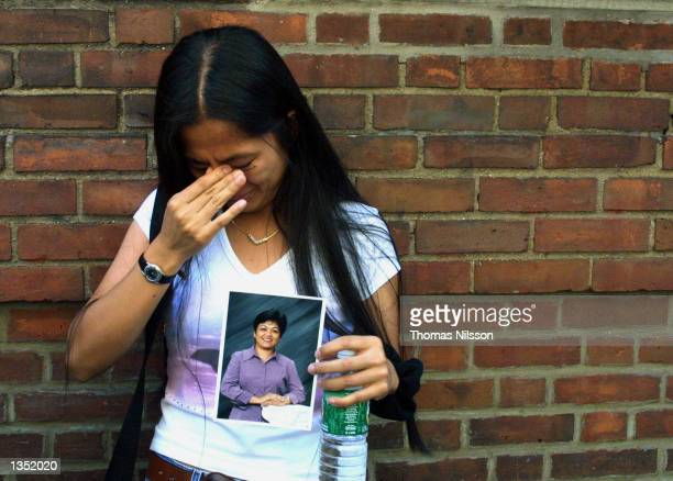 Daisy Domingo from Elmherst, Queens holds a picture of her missing sister Benilda Domingo at the Family Center at the Armory on Lexinton Avenue...