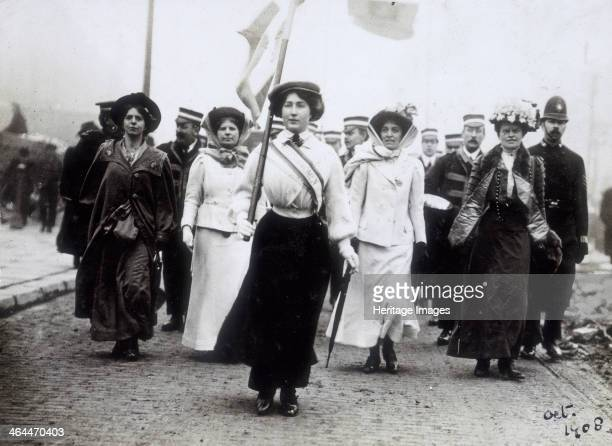 Daisy Dugdale leading a procession London 1908 Wearing the suffragette uniform in the colours of purple green and white Daisy Dugdale leads a brass...