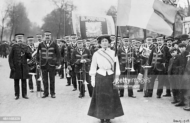 Daisy Dugdale leading the procession to welcome Emmeline and Christabel Pankhurst London 19th December 1908 Wearing the suffragette uniform in the...