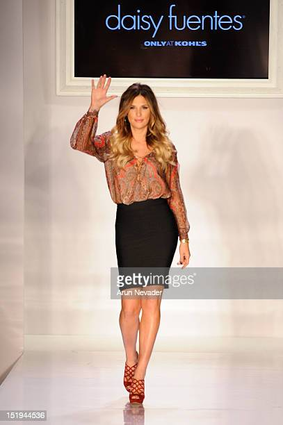 Daisy Fuentes appears on the runway during her spring 2013 fashion show during MercedesBenz Fashion Week at Metropolitan Pavillion on September 12...