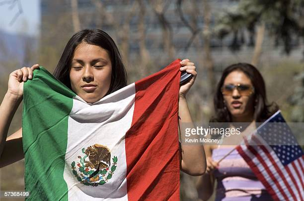 Daisy Gonzales displays a Mexican flag during a rally of about 3000 middle and high school students who walked out of school April 19 2006 in Denver...