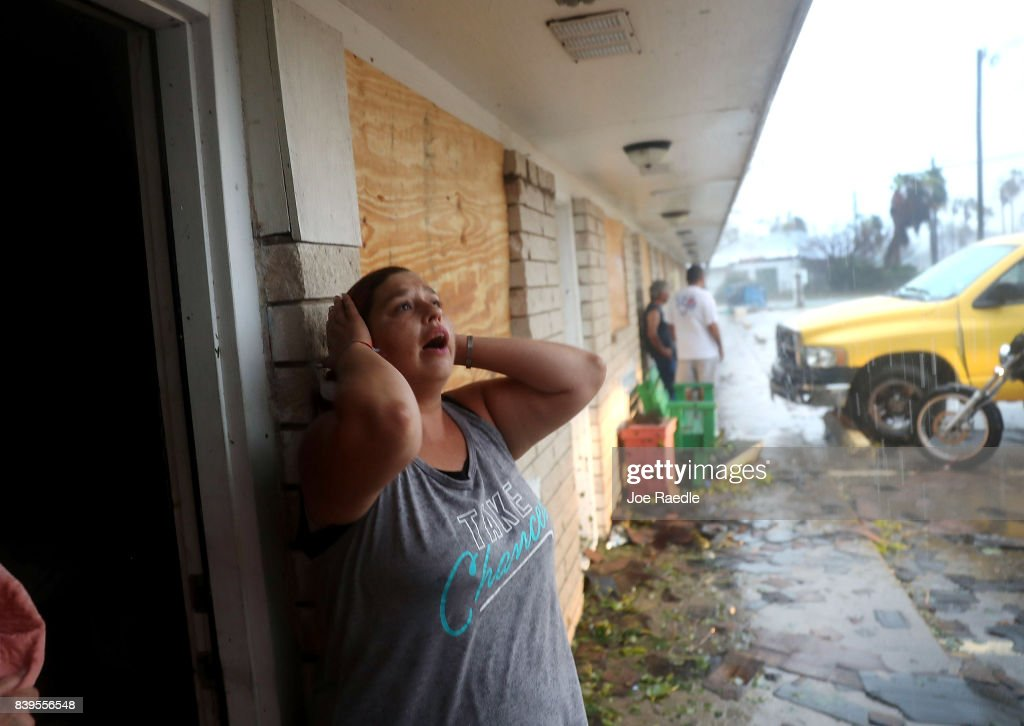 Daisy Graham reacts to the news that a friend of hers may still be in an apartment that was destroyed by Hurricane Harvey on August 26, 2017 in Rockport, Texas. The friends were found alive but still hiding in the shower stall after the homes roof was blown off and walls blown in by the high winds. Harvey made landfall shortly after 11 p.m. Friday, just north of Port Aransas as a Category 4 storm and is being reported as the strongest hurricane to hit the United States since Wilma in 2005. Forecasts call for as much as 30 inches of rain to fall by next Wednesday.