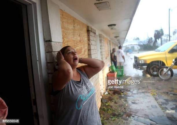 Daisy Graham reacts to the news that a friend of hers may still be in an apartment that was destroyed by Hurricane Harvey on August 26 2017 in...