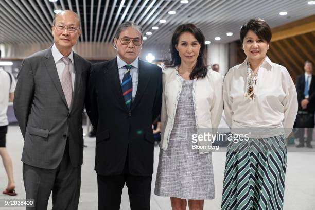 Daisy Ho chairman and executive director of SJM Holdings Ltd second right stands for a photograph with So Shu Fai vice chairman and chief executive...