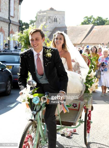 Daisy Jenks and Charlie Van Straubenzee depart after getting married at Saint Mary The Virgin Church on August 4, 2018 in Frensham, United Kingdom....