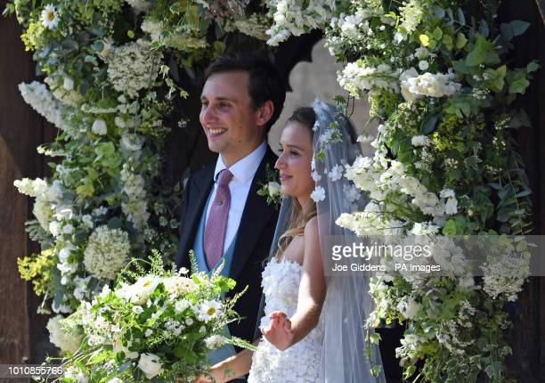 Daisy Jenks and Charlie van Straubenzee outside St Mary the Virgin Church in Frensham Surrey after their wedding ceremony