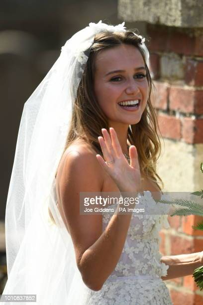Daisy Jenks arrives for her wedding to Charlie van Straubenzee at St Mary the Virgin Church in Frensham Surrey