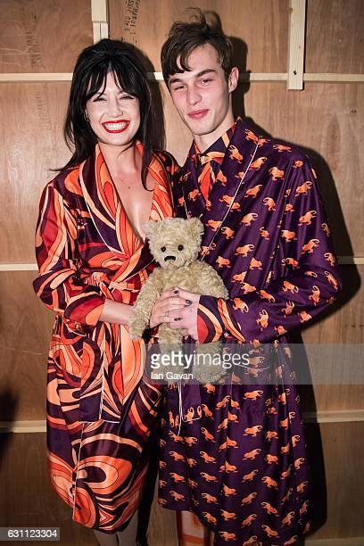 Daisy Lowe and a model pose backstage ahead of the Katie Eary show during London Fashion Week Men's January 2017 collections at BFC Show Space on...