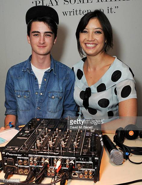 Daisy Lowe and brother Alfie Goffey DJ at the launch of Alexa Chung's first book It at Liberty on September 4 2013 in London England