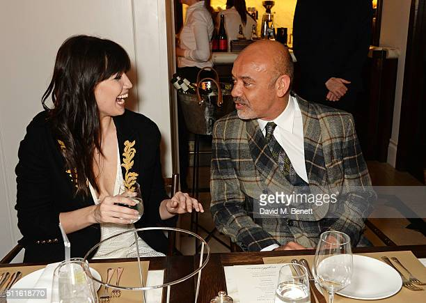 Daisy Lowe and Christian Louboutin attend as mytheresacom and Burberry celebrate the new MYT Woman at Thomas's on February 21 2016 in London England