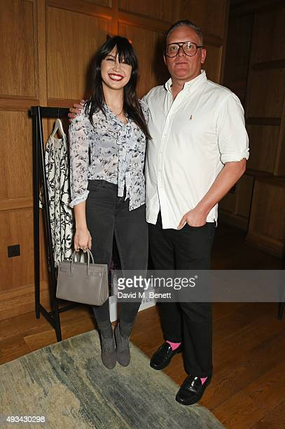 Daisy Lowe and designer Giles Deacon attend a cocktail reception hosted by Giles Deacon to celebrate the launch of the Giles/EDITION collection for...