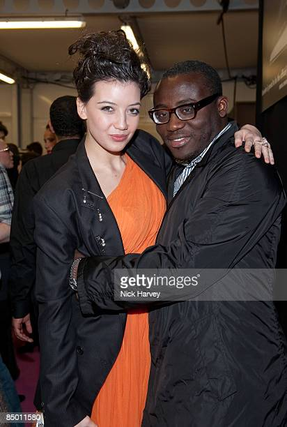 Daisy Lowe and Edward Enninful pose backstage during the ISSA show at London Fashion Week Autumn/Winter 2009 at Natural History Museum on February 23...