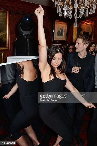 Daisy Lowe and George Barnett attend the Esquire Jimmy Choo party the official launch party of London Collections Men AW15 at Marks Club on January...