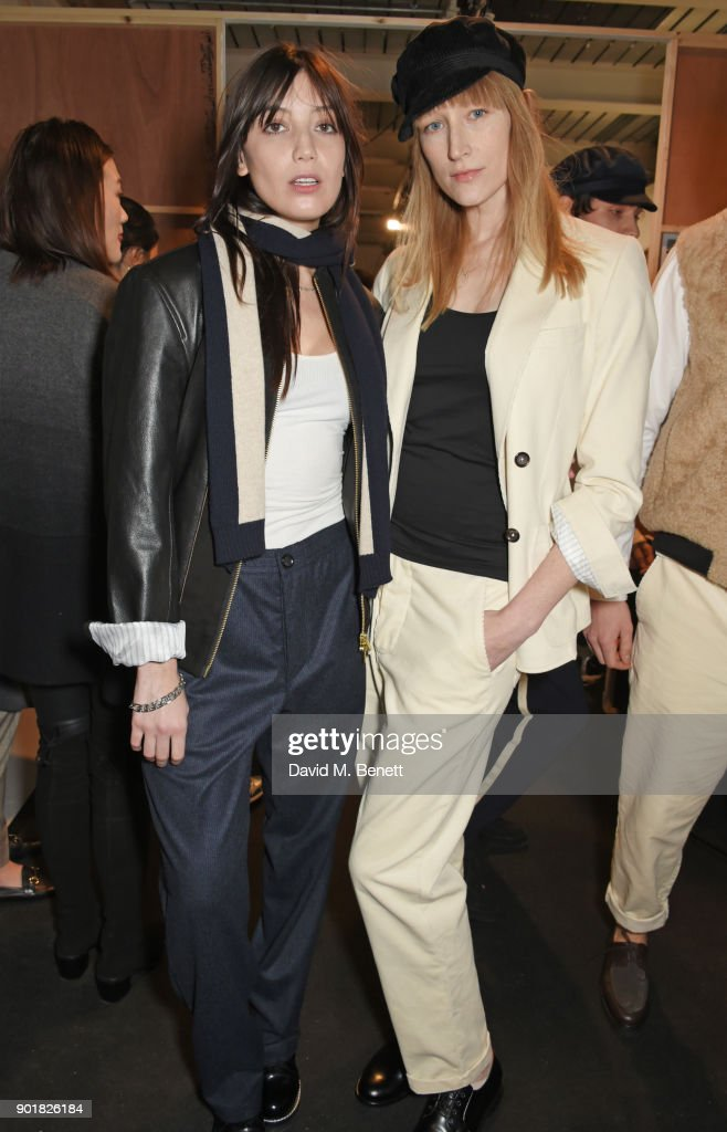 Daisy Lowe (L) and Jade Parfitt pose backstage at the Oliver Spencer LFWM AW18 Catwalk Show at the BFC Show Space on January 6, 2018 in London, England.