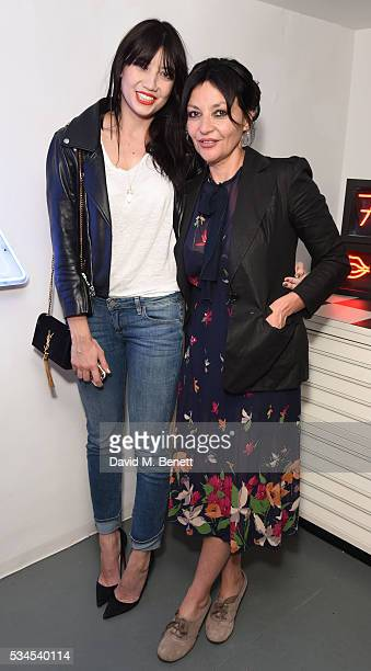 Daisy Lowe and Pearl Lowe attend a private view of 'Art Electric' a collaboration between artists Zoe Grace and John Morrissey at Lawrence Alkin...