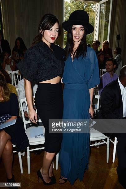 Daisy Lowe and Tao Okamoto attend the John Galliano show as part of the Paris Fashion Week Womenswear Spring/Summer 2014 at Hotel Salomon de...