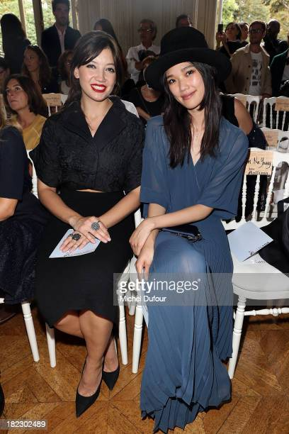 Daisy Lowe and Tao Okamoto attend the John Galliano show as part of the Paris Fashion Week Womenswear Spring/Summer 2014 on September 29 2013 in...