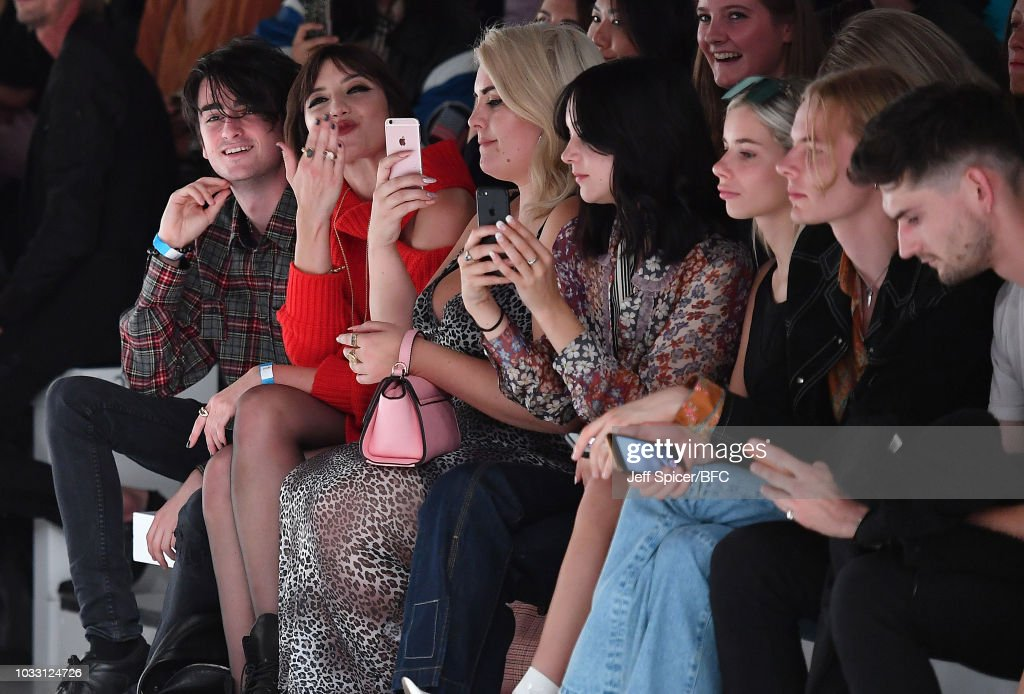 Daisy Lowe (second left) attends the Marta Jakubowski Show during London Fashion Week September 2018 at The BFC Show Space on September 14, 2018 in London, England.