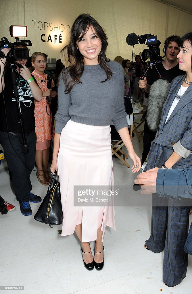 Daisy Lowe attends the Unique SS14 show during London Fashion Week on September 15, 2013 in London, England.