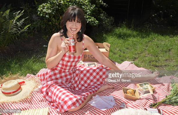 Daisy Lowe celebrates National Picnic Week with a Pimm's in her garden, featured with the limited edition Pimm's x Pique hamper, on June 22, 2020 in...
