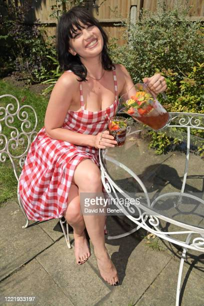 Daisy Lowe celebrates National Picnic Week with a Pimm's in her garden featured with the limited edition Pimm's x Pique hamper on June 22 2020 in...
