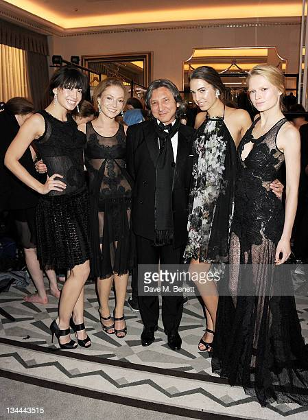 Daisy Lowe Clara Paget Leon Max Amber Le Bon and Katia Elizarova pose backstage after a fashion show at the Leon Max Winter Dinner and Dance for 'Too...