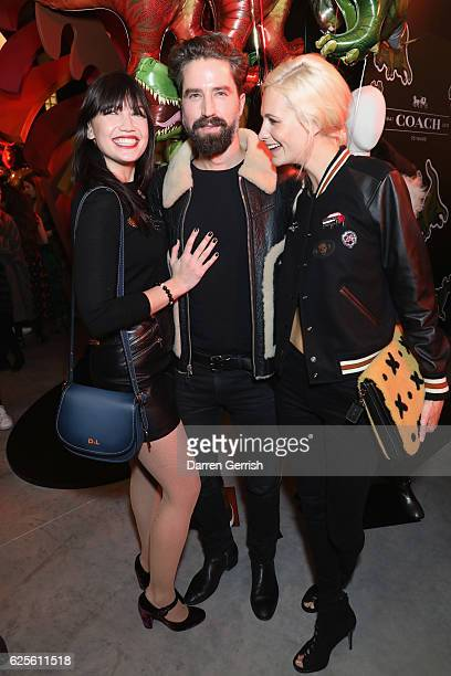 Daisy Lowe Jack Guinness and Poppy Delevingne attend Coach House Regent Street Launch Party on November 24 2016 in London England
