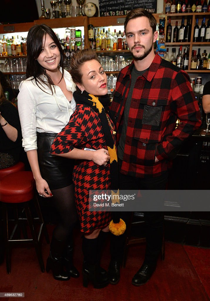 Daisy Lowe, Jaime Winstone and Nicholas Hoult attend the Thanksgiving dinner with Coach hosted by Zoe Kravitz and Mary Charteris on November 24, 2014 in London, England.