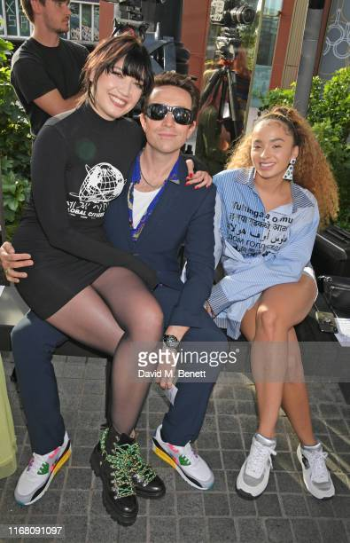 Daisy Lowe, Nick Grimshaw and Ella Eyre attend the House Of Holland front row during London Fashion Week September 2019 on September 14, 2019 in...