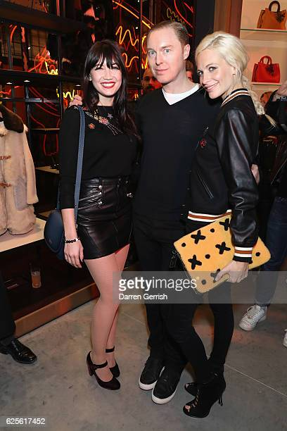 Daisy Lowe Stuart Vevers and Poppy Delevingne attend Coach House Regent Street Launch Party on November 24 2016 in London England