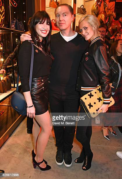 Daisy Lowe Stuart Vevers Coach Creative Director and Poppy Delevingne attend the launch of Coach House Regent Street on November 24 2016 in London...