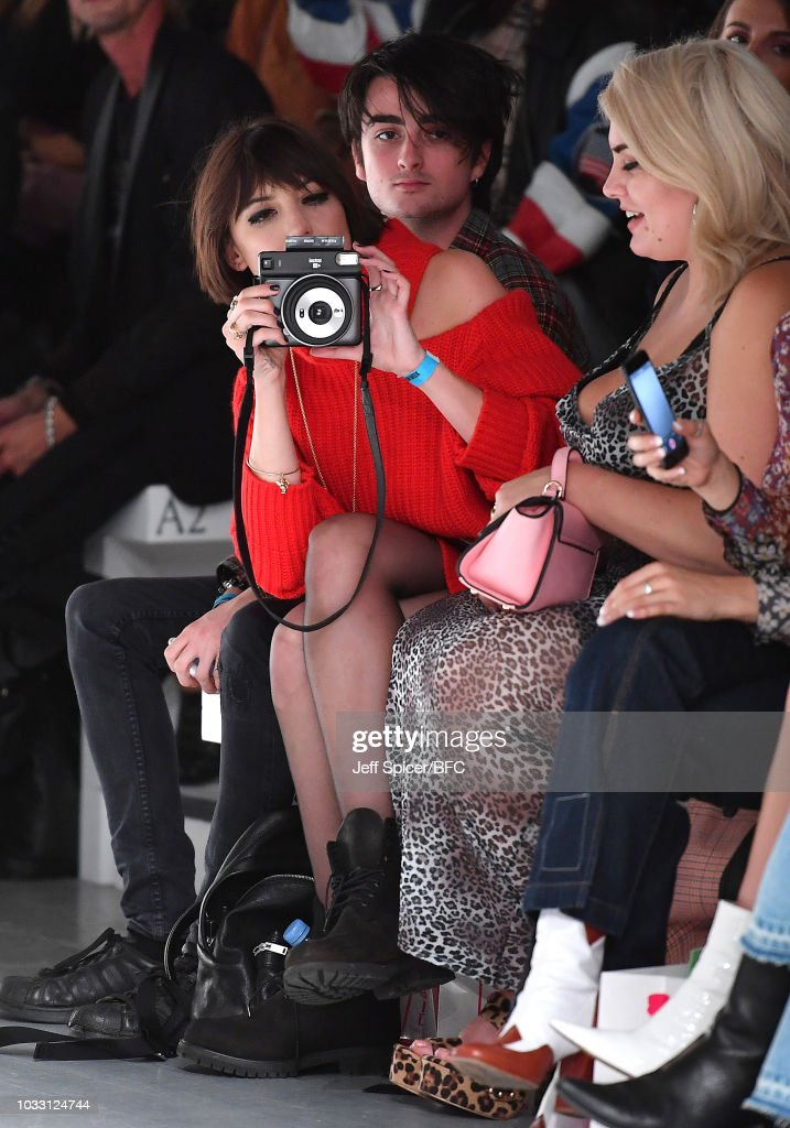 Daisy Lowe takes a picture as she attends the Marta Jakubowski Show during London Fashion Week September 2018 at The BFC Show Space on September 14, 2018 in London, England.
