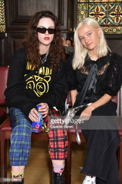 Daisy Maybe and Maddi Waterhouse attend the Ryan LO front row during London Fashion Week September 2018 at Stationers' Hall on September 14 2018 in...