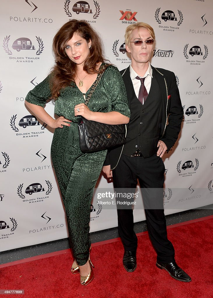 DJ Daisy O'Dell (L) and singer Julian Shah-Tayler attend the 15th Annual Golden Trailer Awards at Saban Theatre on May 30, 2014 in Beverly Hills, California.