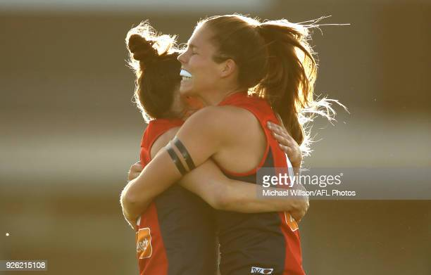 Daisy Pearce and Kate Hore of the Demons celebrate during the 2018 AFLW Round 05 match between the Melbourne Demons and the Brisbane Lions at Casey...