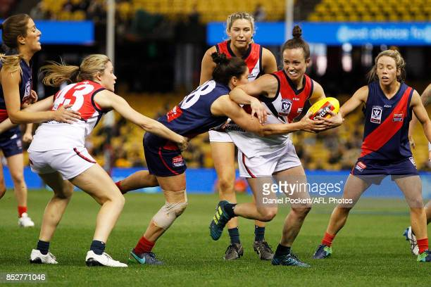 Daisy Pearce of Darebin is tackled by Shae Audley of Diamond Creek during the VFL Women's Grand Final match between Diamond Creek and Darebin at...