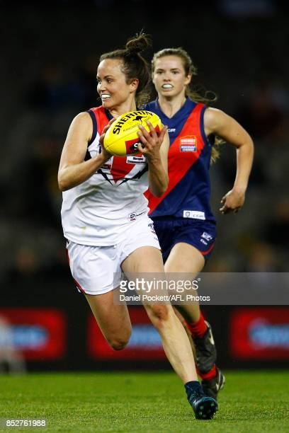 Daisy Pearce of Darebin runs with the ball during the VFL Women's Grand Final match between Diamond Creek and Darebin at Etihad Stadium on September...
